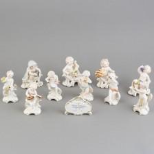 Figuriineja, 10 kpl ja kyltti